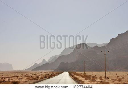 Asphalt road to Wadi Rum valley in Jordan.