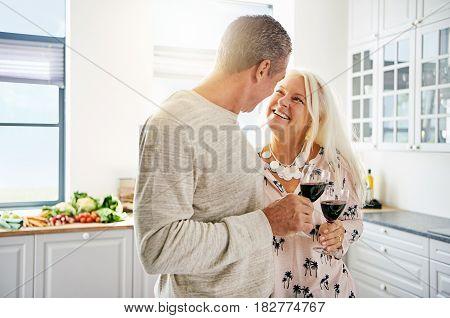 Affectionate Senior Couple Drinking Wine