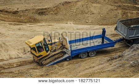 Truck Is Moving A Bulldozer