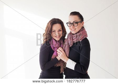two girls cuddling a laughing glasses kardegan