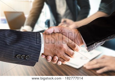 Acquisition concept. Handshake of businessmen on blur business people background vintage tone and greeting dealing merger.