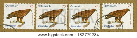 GOMEL, BELARUS, APRIL 20, 2017. Stamp printed in Austria shows image of  The Aquila chrysaetos, circa 2010.