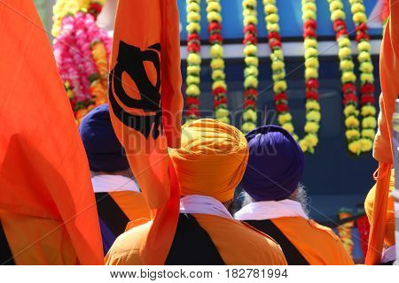 Sikh Men With Flags During Festival On The Road