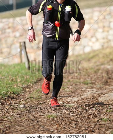 Man Runs With Sportwear During A Cross-country Race