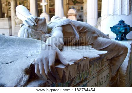 The beauty of despair seen through a cemetery statue