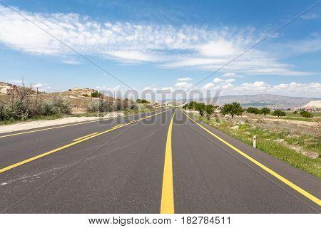 Road in summer mountains valley Cappadocia Turkey