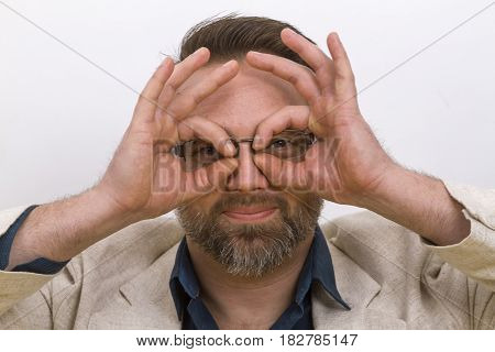 Young Man focussing the future - on bright background