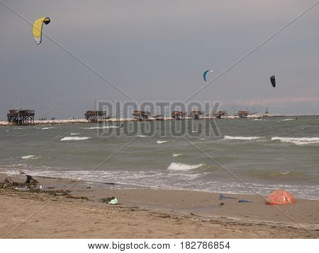 Kitesurfing on the beach of Chioggia, Italy, before the thunderstorm.