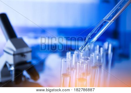 Lab experiment. Laboratory concept background. Tubes during experiment in laboratory. Colorful bokeh.