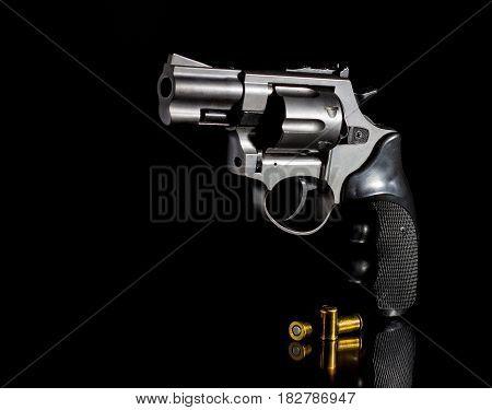 Gun with ammunition on a black background