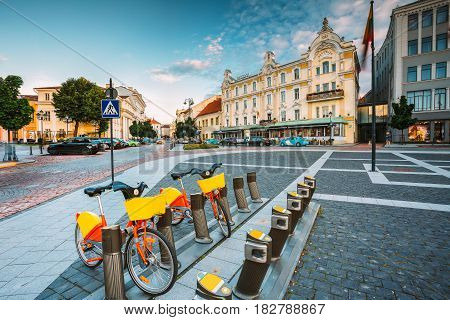 Vilnius, Lithuania. Two Colorful Bicycles For Rent At The Municipal Bike Parking On Didzioji Street, The Ancient Showplace In Old Town