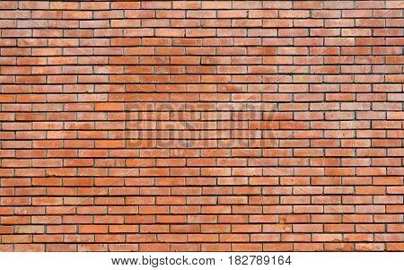 Red brick wall texture. Vintage exterior brickwork backdrop.