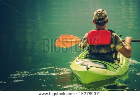 Senior Kayaker on the Calm Lake Water. Kayak Tour.