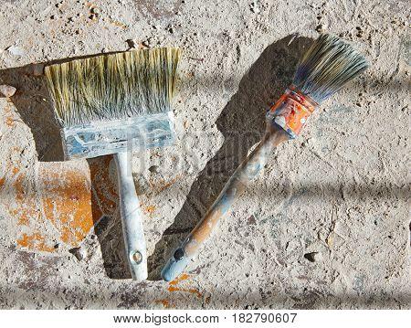 Paint brushes used on debris improvement background