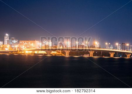 Night city bridge on the river, light car, View move, street, freeway, the city road at night