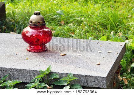 Votive candle on grave Grave candle, copy space