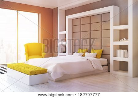 Side view of a gray wall bedroom with a panoramic window and a yellow armchair standing beside a double bed. 3d rendering toned image.