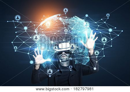 African American man in vr glasses looking at a network sketch and the Earth. Toned image double exposure.
