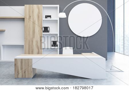 Interior of a clerk office with a gray wall a round poster hanging on it a large desk and a bookcase with folders. 3d rendering mock up