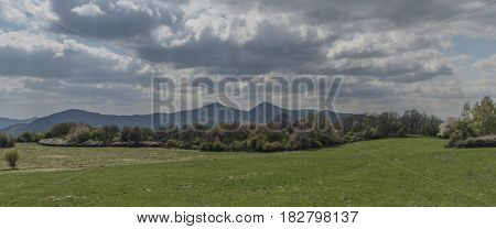 Green cloudy day in Ceske Stredohori mountains in spring time