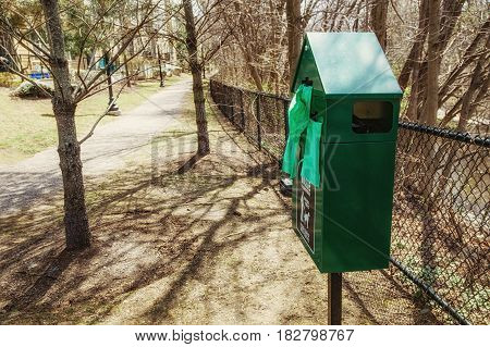 BOSTON, MA, USA - APRIL 17 2017: free bags in the park for cleaning the poop after the dogs