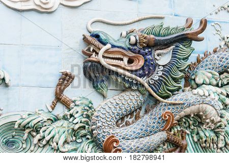 Gunagdong, China - Nov 28 2015: Dragon Relief At Foshan Ancestral Temple(zumiao Temple). A Famous Hi