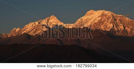Mountain peaks of the Manaslu range at sunset. View from Ghale Gaun Nepal.