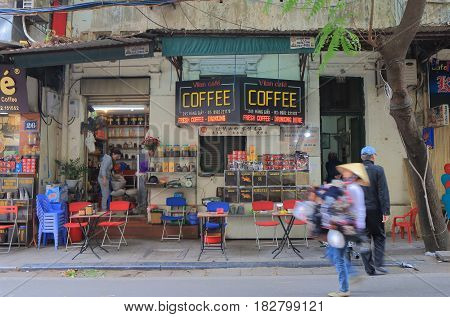 HANOI VIETNAM - NOVEMBER 24, 2016: Unidentified people visit coffee shop in Hanoi Old Quarter.