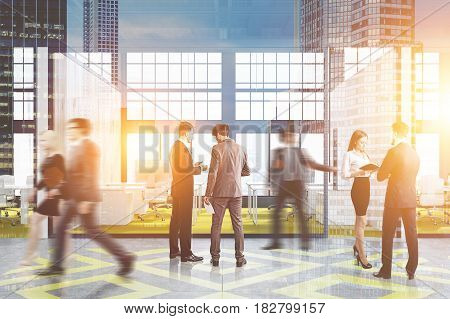 People in an office cubicle with a bright yellow floor white tables and computers on them in a loft. 3d rendering toned image double exposure.