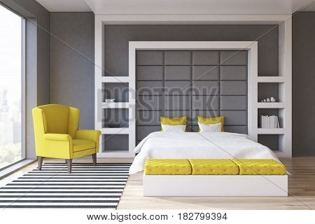 Front view of a gray wall bedroom with a panoramic window and a yellow armchair standing beside a double bed. 3d rendering.