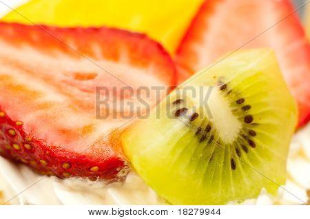 Strawberries Kiwi And Slice Of Peach On Cream