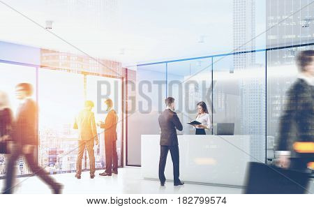 Side view of businesspeople passing by a reception counter in an office with gray walls. 3d rendering toned image double exposure