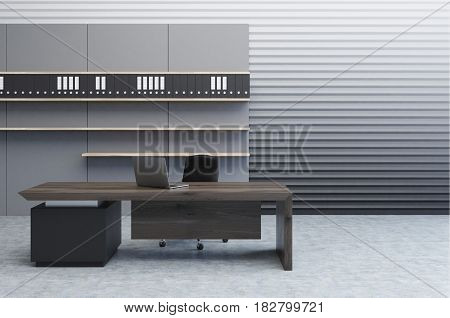 Interior of a clerk office with a gray perforated wall a large desk and a bookcase with folders standing on them. 3d rendering mock up