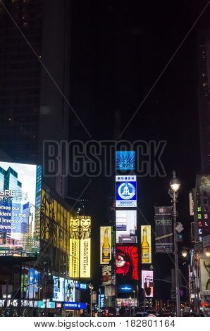 Illuminated Facades Of Broadway Stores And Theaters
