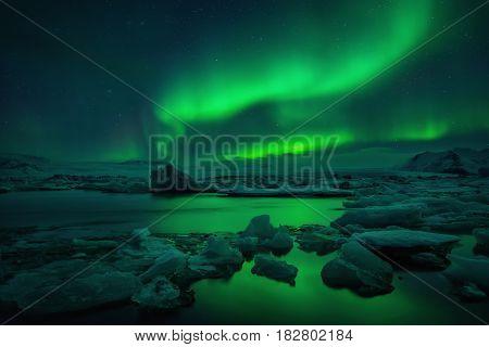 Aurora borealis above Jokulsarlon glacial lagoon Iceland