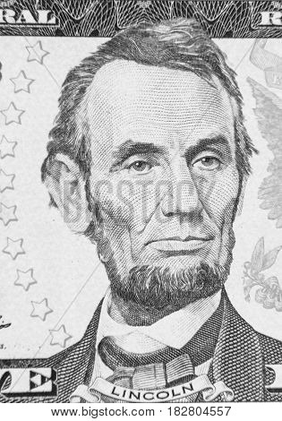 Closeup of Abraham Lincoln on five dollar American banknote