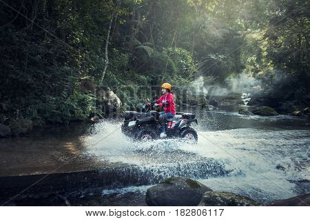 Woman on the ATV Quad Bike on the mountains road