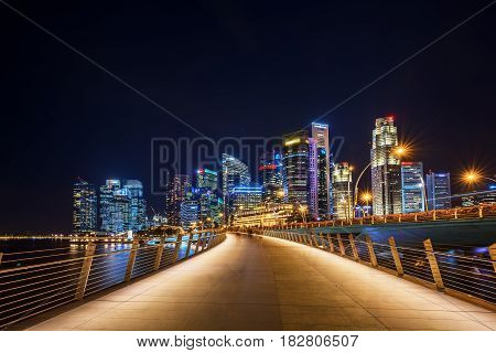 Walkway into the city Singapore cityscape at nigth