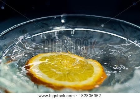 tropical fruits Orange fall deeply under water with a big splash