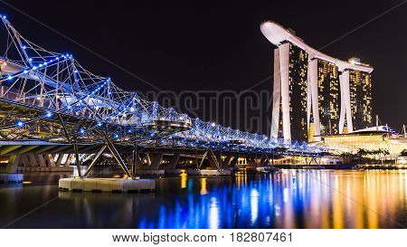 Marina Bay Singapore - April 11 2015 : Marina bay sands and helix bridge are highlight place of Singapore