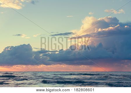 Beautiful seascape evening Baltic sea sunset horizon and cloudy sky. Tranquil scene. Natural background. Landscape.