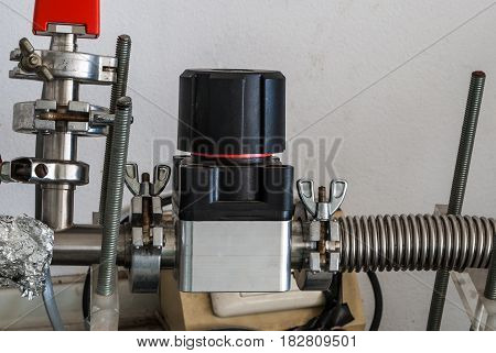 Closeup to Regulator Valve with Metal Flexible Pipe