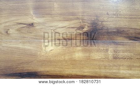 Brown scratched wooden cutting board and background,