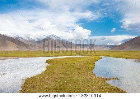 Xinjiang, China - May 20 2015: Karakul Lake. A Famous Landscape On The Karakoram Highway In Pamir Mo