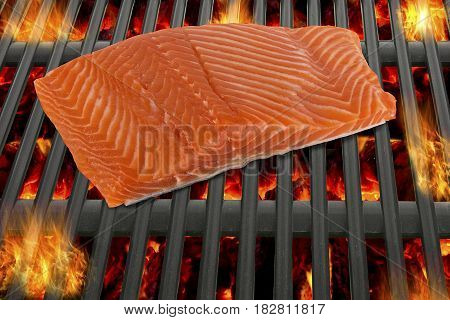 Cooking salmon fillet on barbecue. Top view.