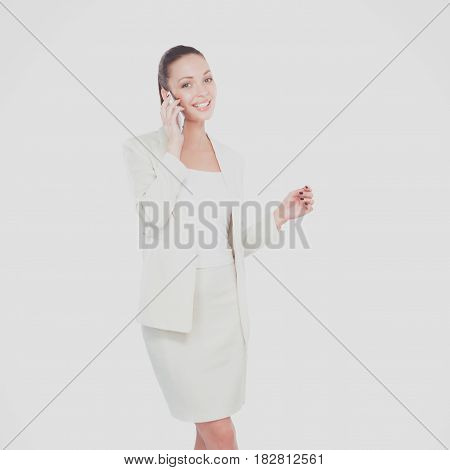 Portrait of a beautiful smiling woman using a mobile phone.