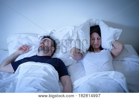 Tired And Annoyed Woman Of Her Boyfriend Snoring In Bed