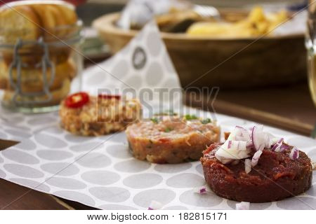 Delicious chicken, beef tartar spread over the table