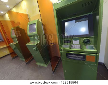 Three cash dispensers for issuing money green ready for work