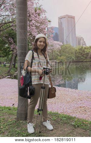Women photographing flowers background. Chompoo Pantip flower thailand